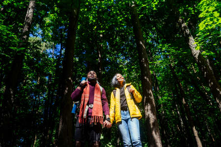 latin american man and hispanic woman in a forest having a rest Stockfoto