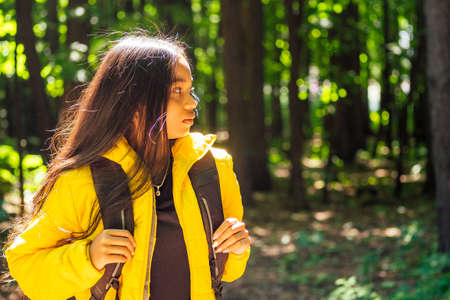 african american woman in yellow jacket outdoors