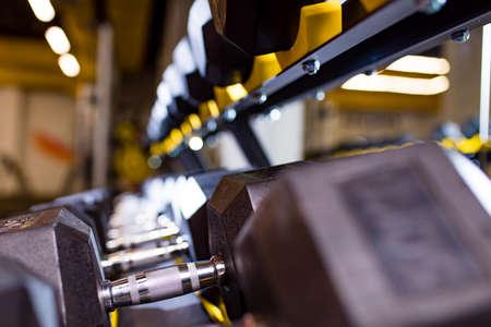 close up shot of dumbbells in modern gym