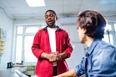 african american student having class with arabian teacher indoors 版權商用圖片