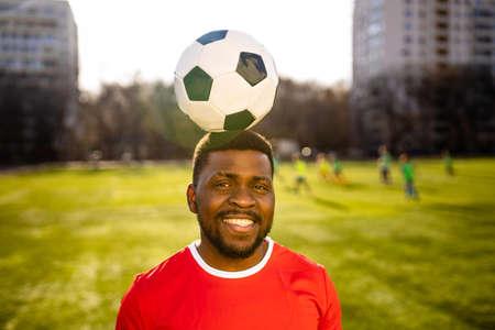 brazilian football player on stadium kicking ball for winning goal outdoors Imagens
