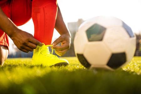 authentic happy football trainer working out outdoor in summer great day Imagens