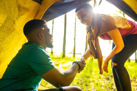 african people on camping trip welcoming a new day in summer park