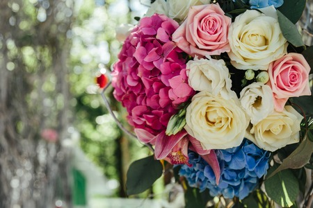 private party: Beautiful fresh flowers roses on wedding ceremony