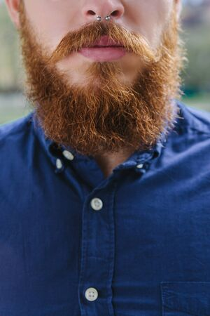 nosering: Bearded hipster with piercing in the city outdoor Stock Photo