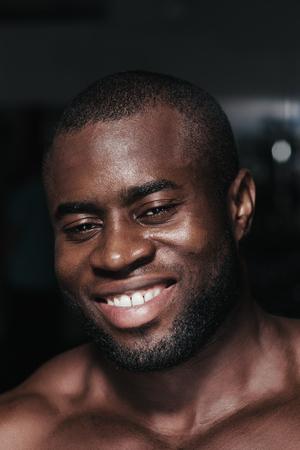 american sport: Weight training African bodybuilder portrait in gym