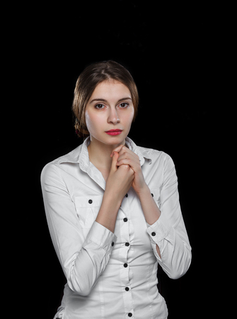 decent: Young casual woman isolated over black background studio portrait