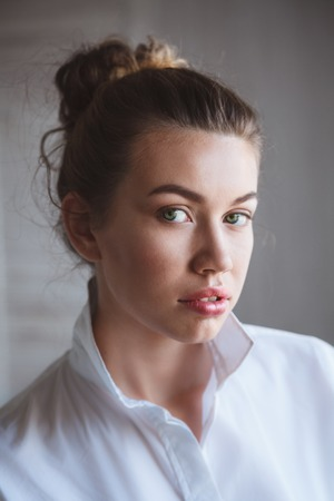 light complexion: Portrait close up of young beautiful woman in studio Stock Photo