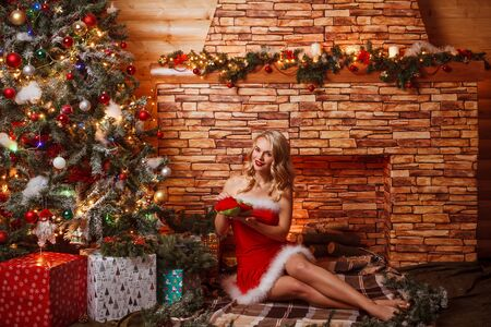 young girl models: Beautiful attractive woman in Santa Claus clothes indoor