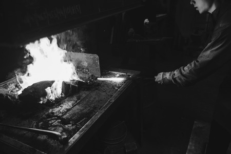 medieval blacksmith: The smith working with hot metal near horn