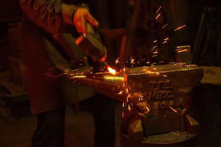 anvil: A blacksmith forging hot iron on the anvil Stock Photo