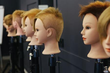 beautician: Beautician model heads for practicing beauty techniques in beauty school