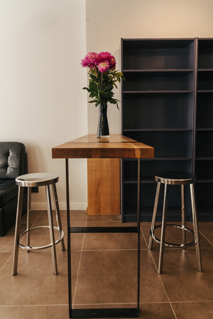 bar stool: counter with seat bar stool wood and steel Stock Photo