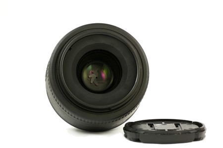 A 35mm prime dslr lens in detail isolated on white background frontal view photo