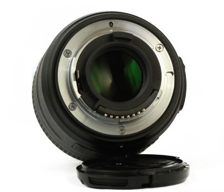 A 35mm prime dslr lens in detail isolated on white background rear view photo
