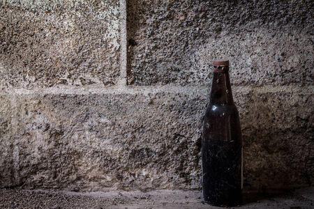 old bottle on cement background photo