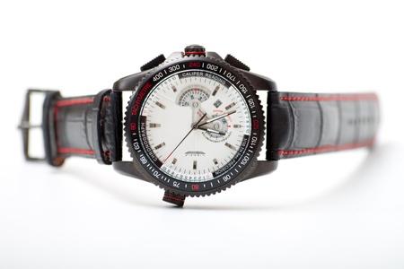 men s black wristwatch on the white photo