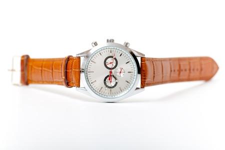 men s metal wristwatch on the white photo