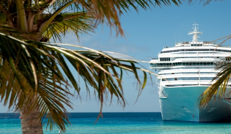 caribbean island: white luxury cruise ship and palm tree