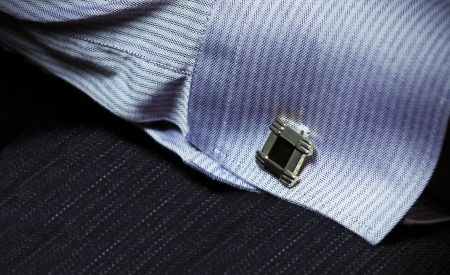 cuff link: hand of a man in a shirt with cuff link