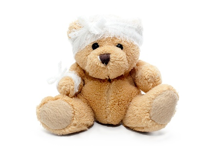 teddy bear with bandaged head isolated photo
