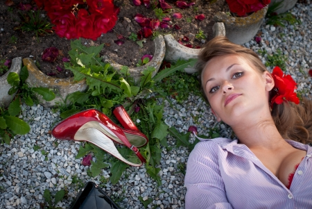 Beautiful sexy young woman lying on the ground photo