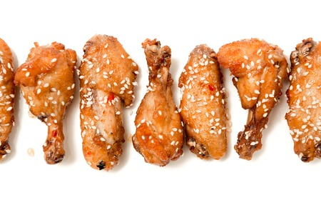 set of fried chicken legs isolated photo