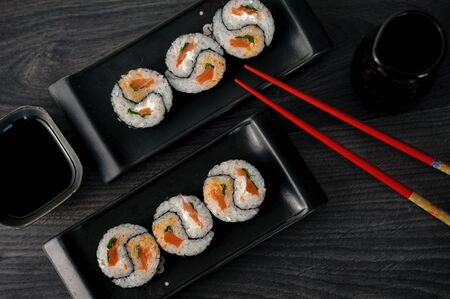 sushi: delicious sushi rolls on the plate close up