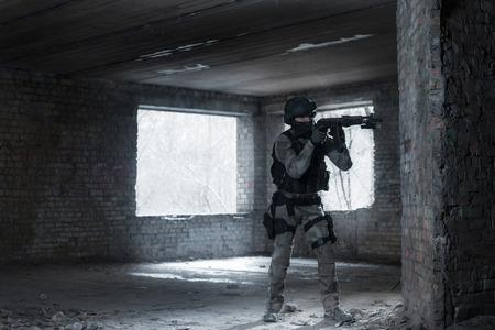 airsoft: Airsoft strikeball player in military soilder uniform in action