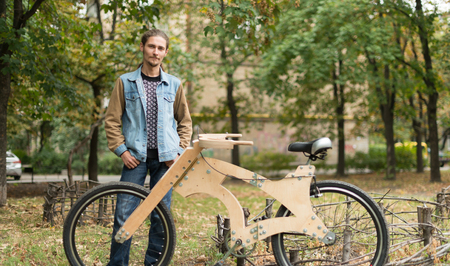 Hipster man with his cruiser wooden handmade bicycle Stock Photo