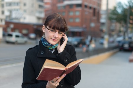 Young woman reading a book in City urban Stock Photo