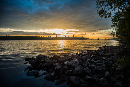 View on the Drepr Dnieper Dnipro river and cityscape at evening in Kiev, Ukraine