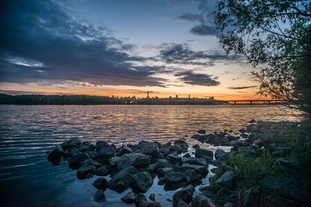 dnepr: View on the Drepr Dnieper Dnipro river and cityscape at evening in Kiev, Ukraine