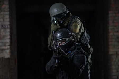 airsoft: Fully equipped military men with automatic weapons playing in  airsoft strikeball