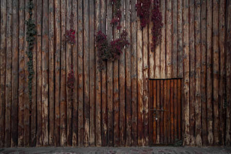 Close up of  wooden fence  and door aged