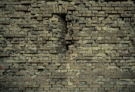 Aged old brick wall texture with cracks and dents Stock Photo