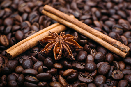 Star anise and cinnamon on coffee beans close up   Stock Photo