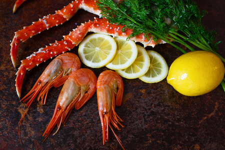 The composition of the shrimp and crab meat with lemon and herbs Stock Photo