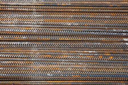 corroded: Thick rusty rebar-rods, metallic texture pattern.