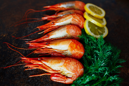 Shrimp close-up with lemon and greens