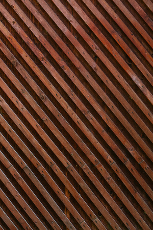 Faded wooden planked grid fence texture background. Vintage effect.