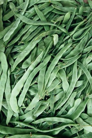 green beans on the counter market for sale as background