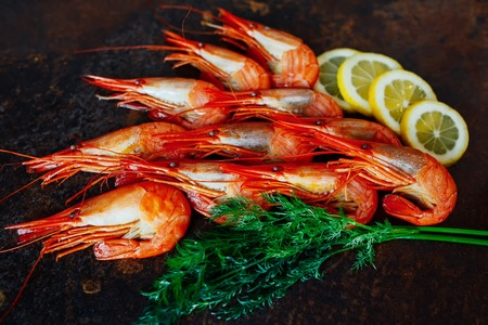 Beautiful shrimp with lemon and greens