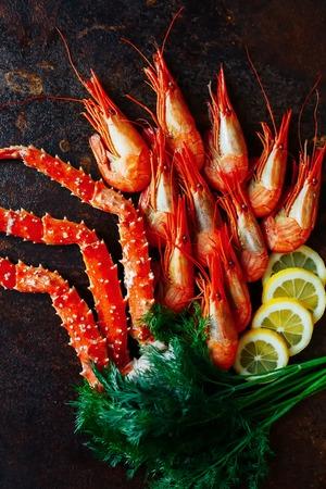 Beautiful shrimp with crab meat lemon and greens Фото со стока