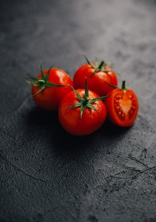 fresh tomato on black background