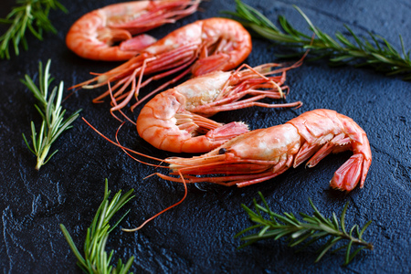 Shrimp with rosemary on a dark background