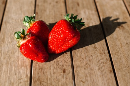 Ripe red strawberries on wooden table. Fresh juice strawberry, healthy food photo