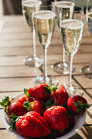 Champagne in a glass with strawberries