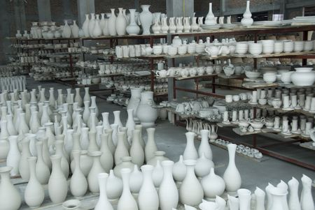 parallelism:   storehouse product at the factory ceramicses