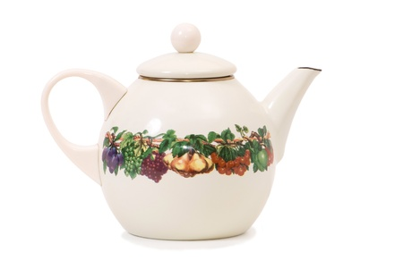 teapot enamel with drawing, on white background photo